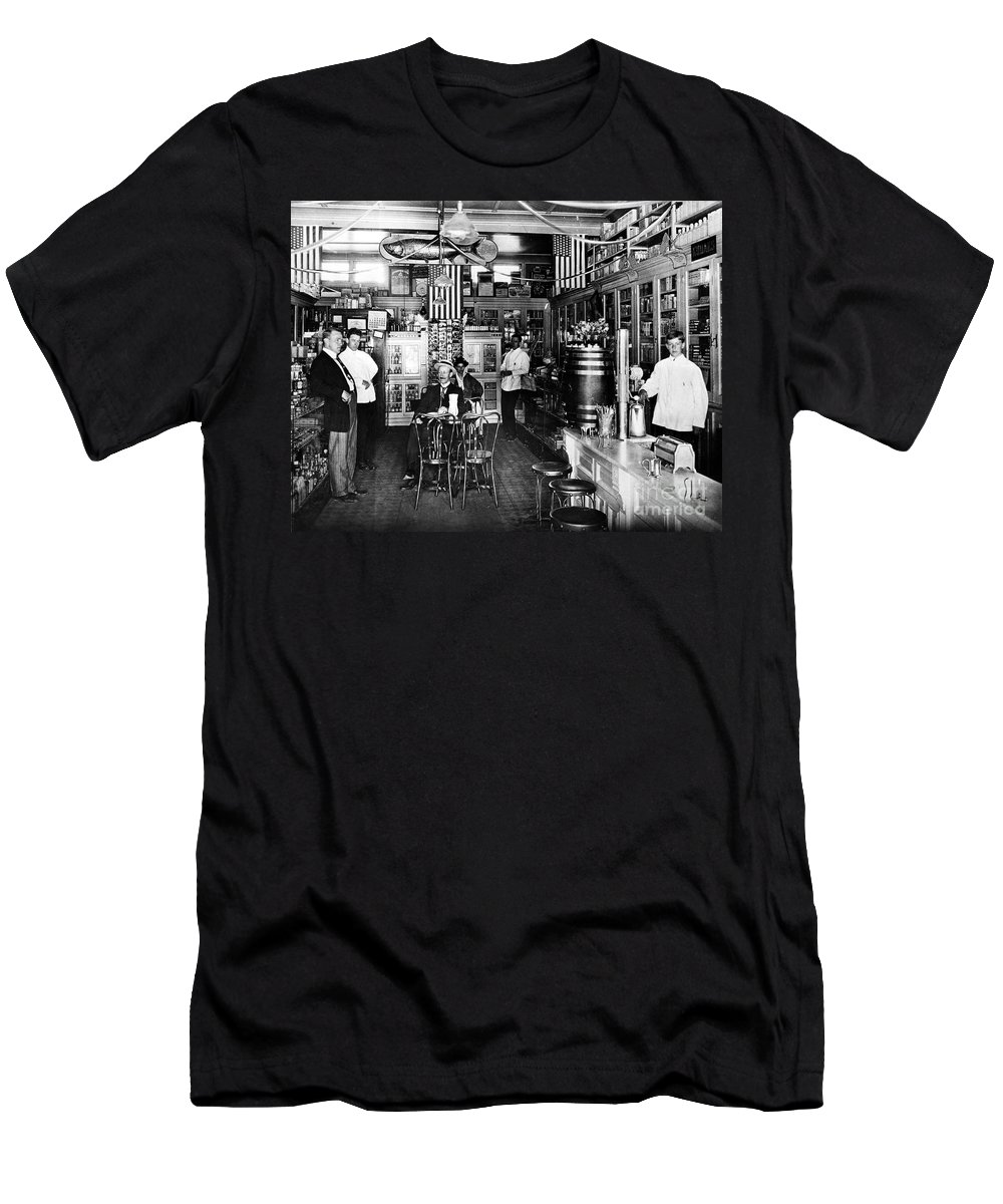 1914 Men's T-Shirt (Athletic Fit) featuring the photograph Collins Pharmacy, 1914 by Granger