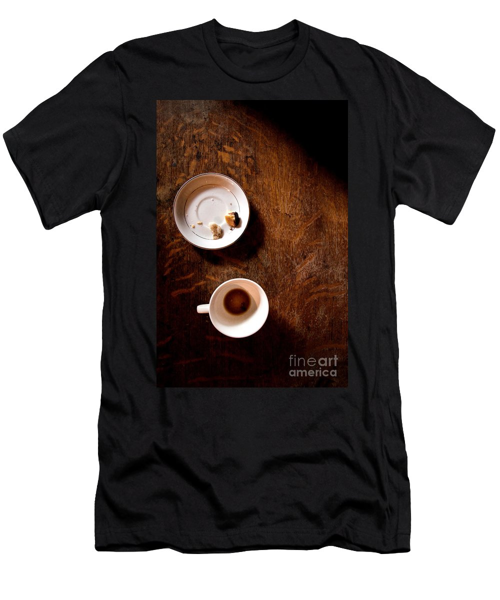 Table; Wood; Wooden; Shadows; Cup; Mug; Coffee; Empty; Drink; Drunk; Saucer; Plate; Food; Crumbs; Bread; Pastry; Pieces; Eaten; Eat; Breakfast; Brunch; Mystery; Mysterious; Foreboding; Dark; Darkness; Thriller Men's T-Shirt (Athletic Fit) featuring the photograph Done by Margie Hurwich