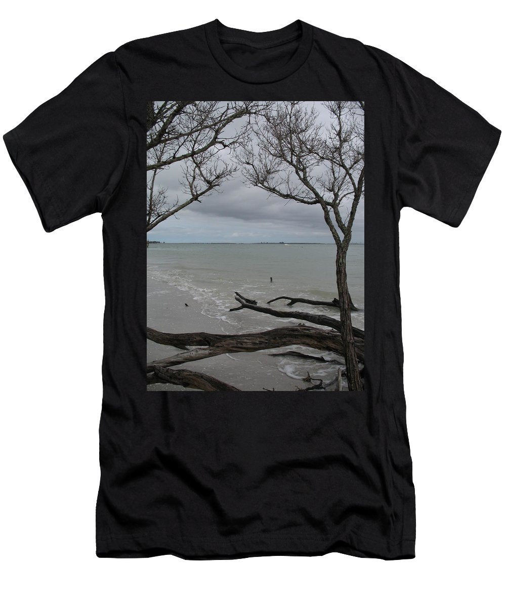 Beach Men's T-Shirt (Athletic Fit) featuring the photograph Driftwood On The Beach by Christiane Schulze Art And Photography