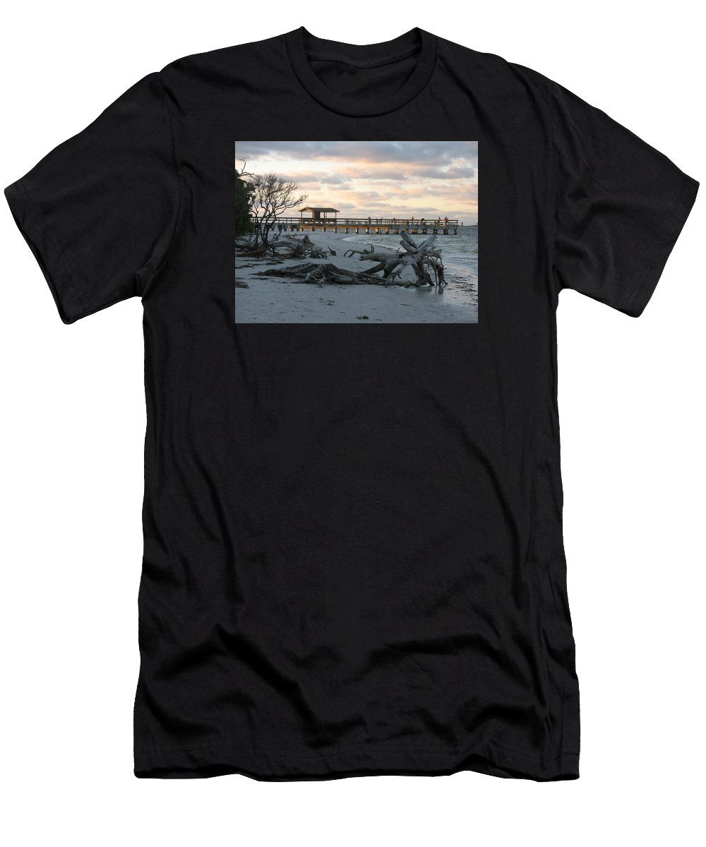Fishing Pier Men's T-Shirt (Athletic Fit) featuring the photograph Fishing Pier And Driftwood by Christiane Schulze Art And Photography