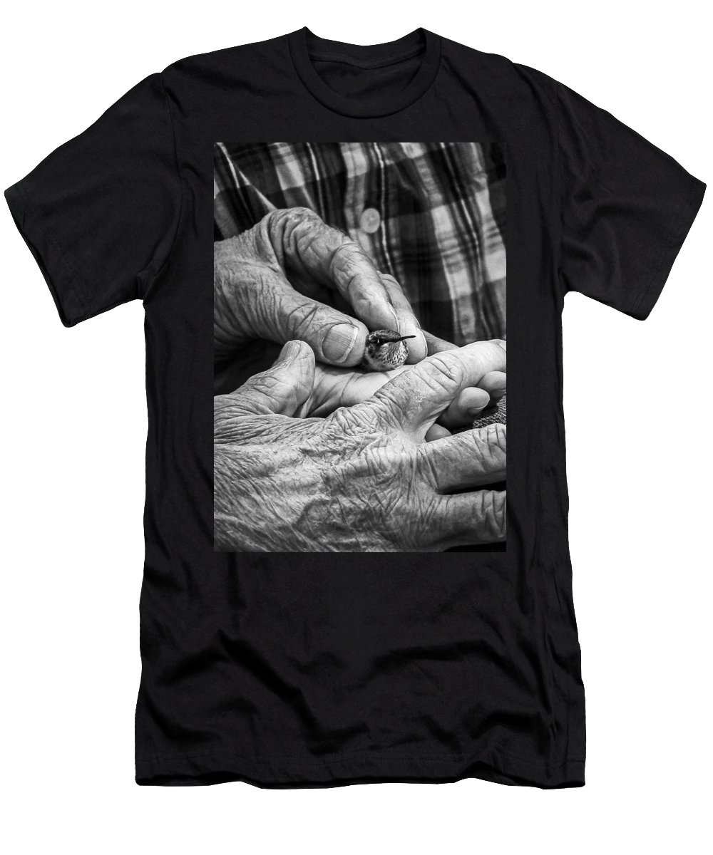 Hummingbird Migration Festival Men's T-Shirt (Athletic Fit) featuring the photograph Hands Holding A Hummingbird by Jon Woodhams