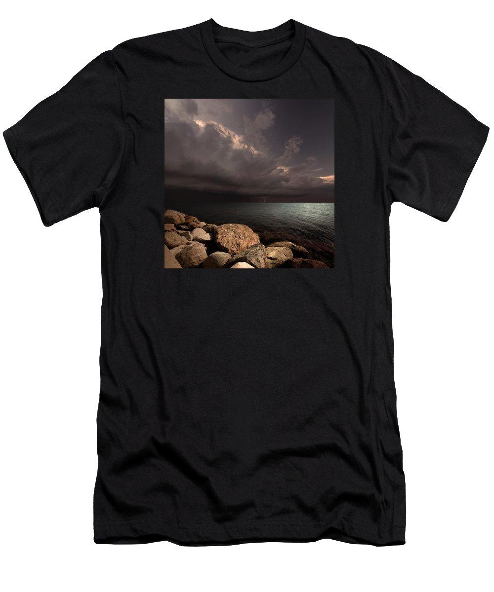 Sea Clouds Bay Water Seascape Landscape Balticsea Rocks Shore Storm Light Lightning Calm Sun Sky Nature Photomontage Photomanipulation T-Shirt featuring the photograph Heart of the Tempest by Michal Karcz