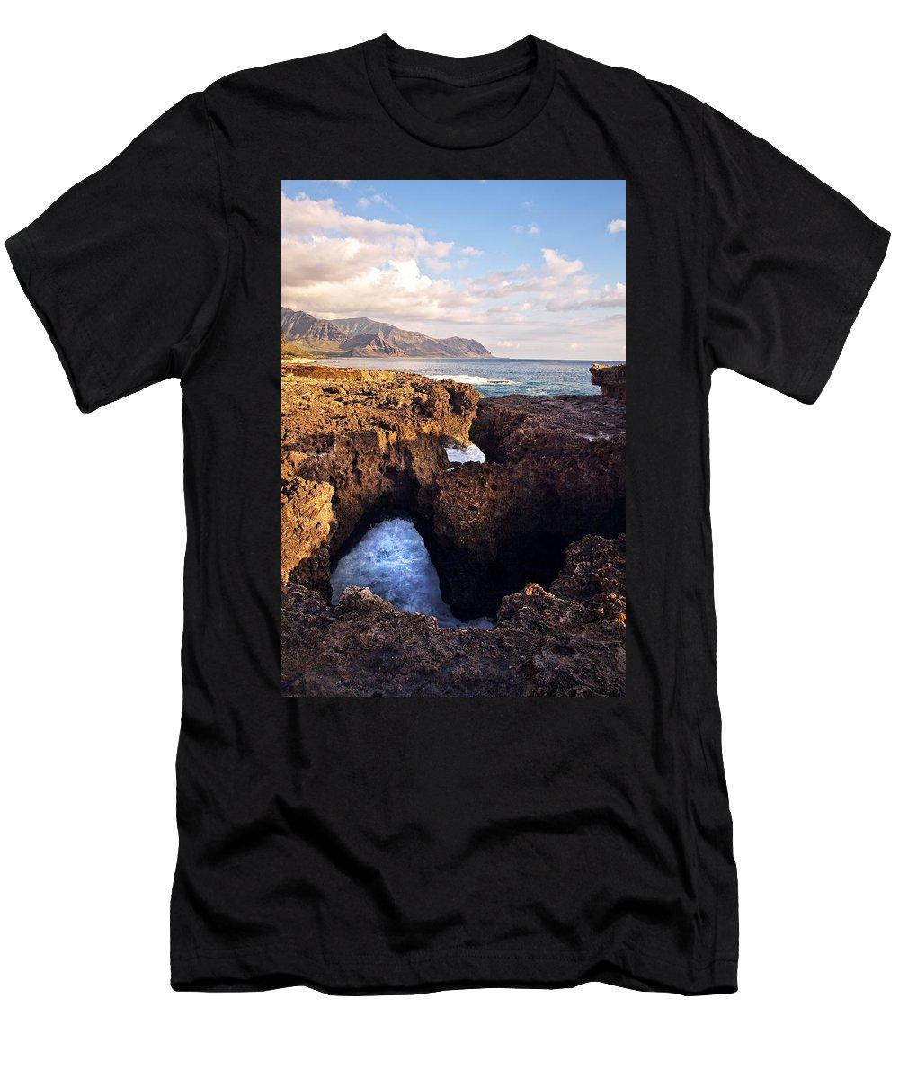 Landscape Men's T-Shirt (Athletic Fit) featuring the photograph Ka'ena Point Natural Bridge by Marcia Colelli