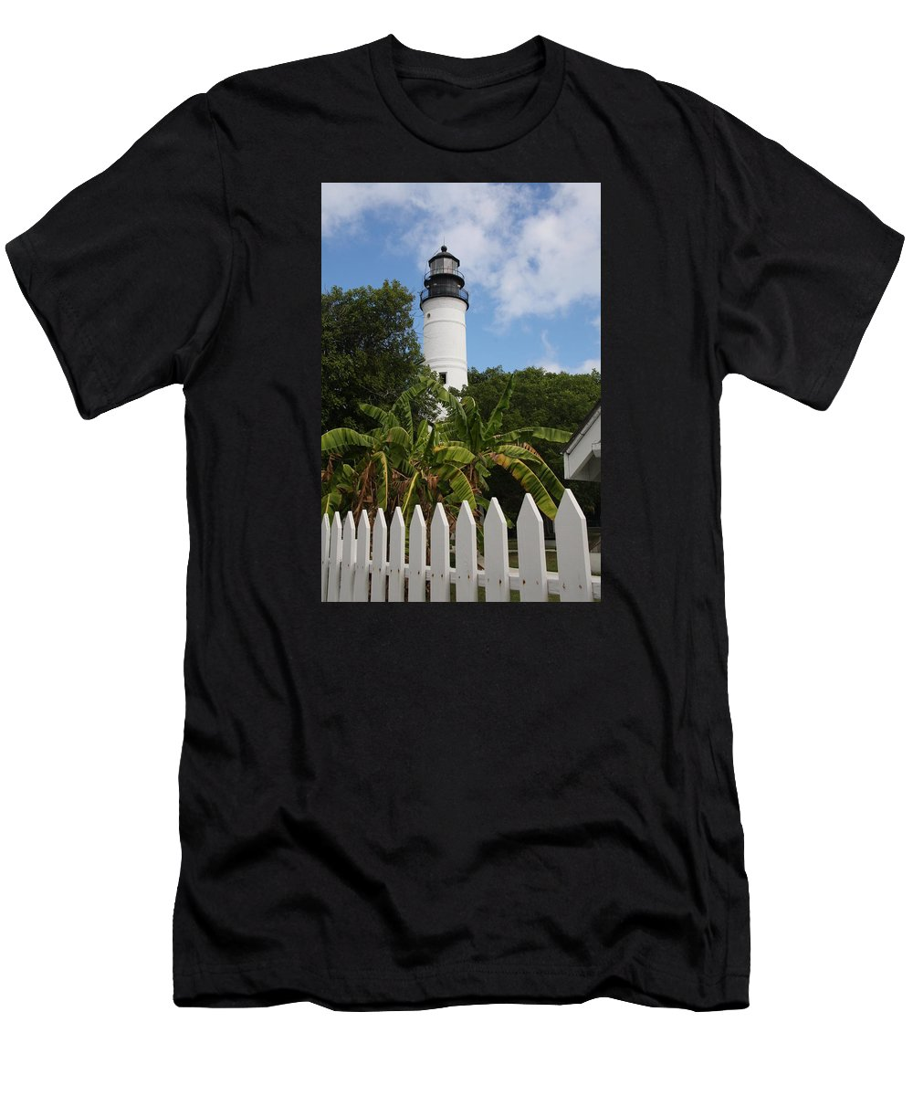 Ligthouse Men's T-Shirt (Athletic Fit) featuring the photograph A Sailoirs Guide On The Florida Keys by Christiane Schulze Art And Photography