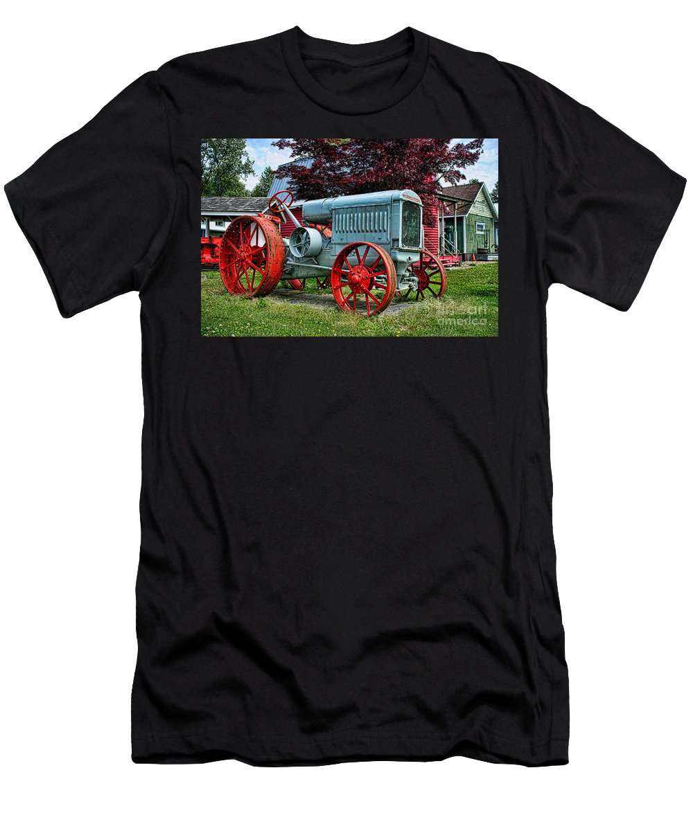 Tractors Men's T-Shirt (Athletic Fit) featuring the photograph Mccormick Deering Red-wheeled Tractor by Randy Harris