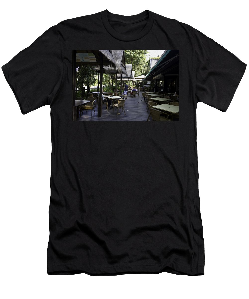 Asia Men's T-Shirt (Athletic Fit) featuring the photograph People At The Breakfast Table In A Hotel In Sentosa In Singapore by Ashish Agarwal