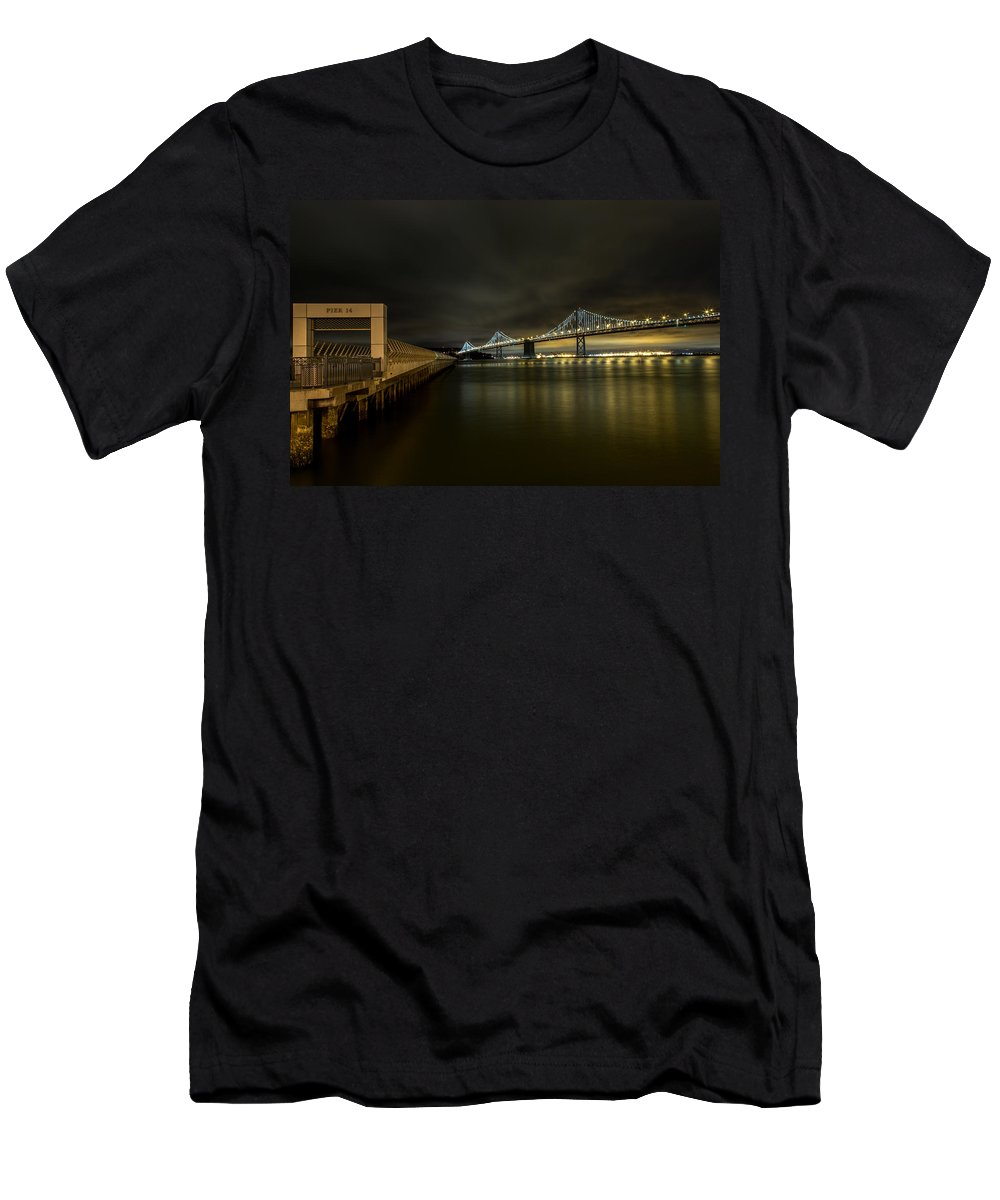 San Francisco Men's T-Shirt (Athletic Fit) featuring the photograph Pier 14 And Bay Bridge At Night by John Daly