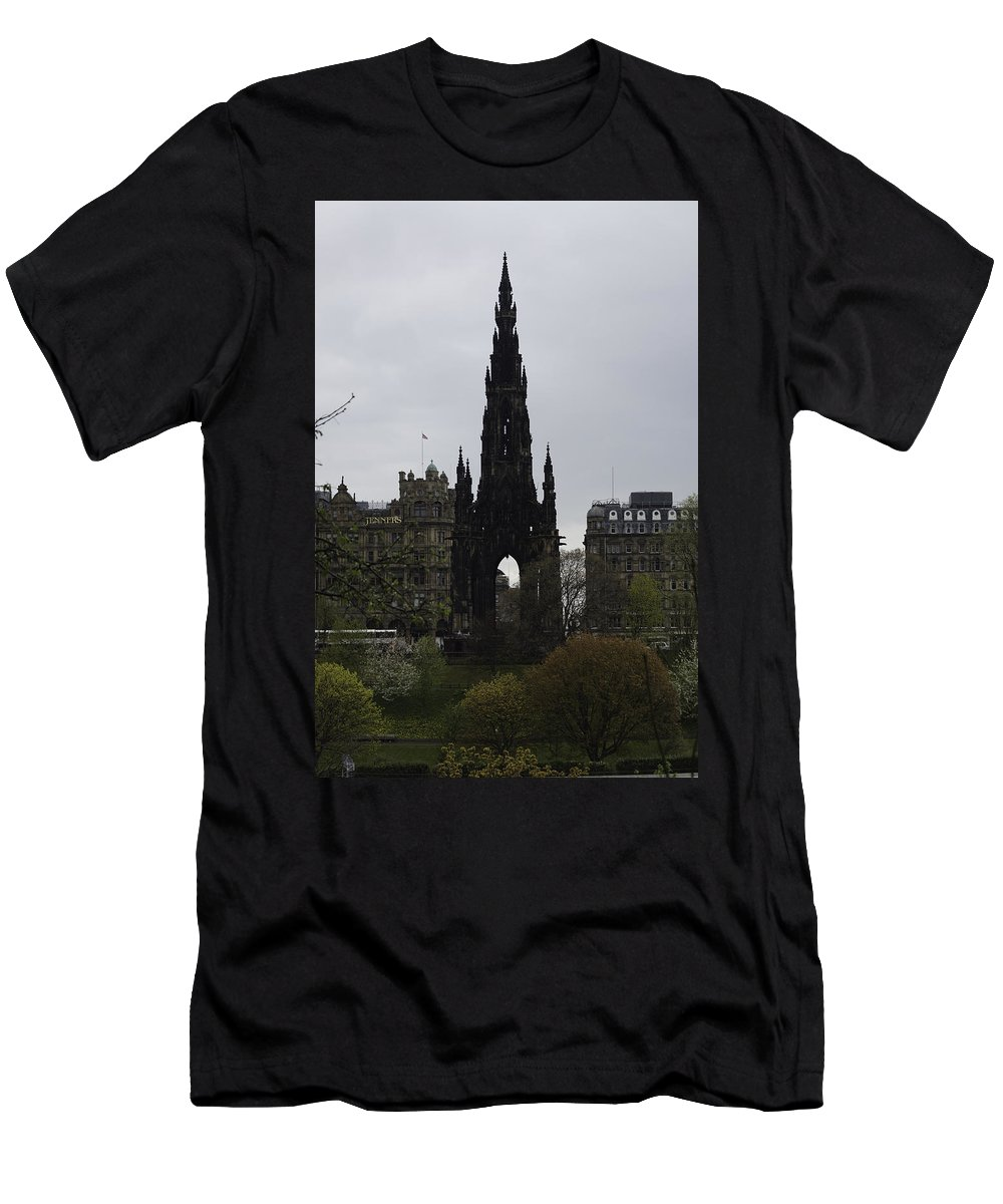Action Men's T-Shirt (Athletic Fit) featuring the photograph Scott Monument Inside The Princes Street Gardens In Edinburgh by Ashish Agarwal