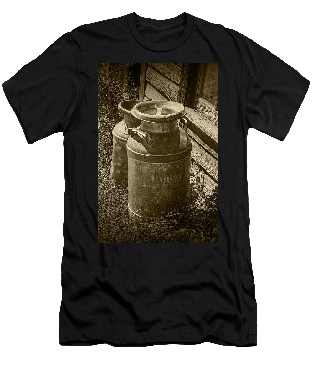 Creamery Can Men's T-Shirt (Athletic Fit) featuring the photograph Sepia Photo Of Vintage Creamery Cans At The Old Prairie Homestead Near The Badlands by Randall Nyhof