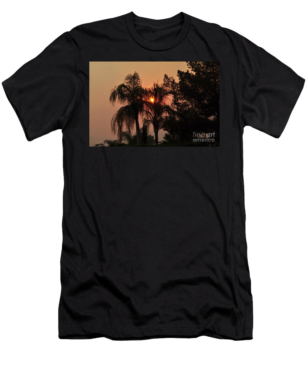 Sky Men's T-Shirt (Athletic Fit) featuring the photograph Smoke Covered Sky Sunset Thru The Palm Trees by Jay Milo