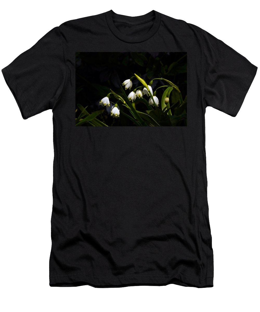 Snowdrops Men's T-Shirt (Athletic Fit) featuring the photograph Snowdrops And Dark Background by Byron Varvarigos