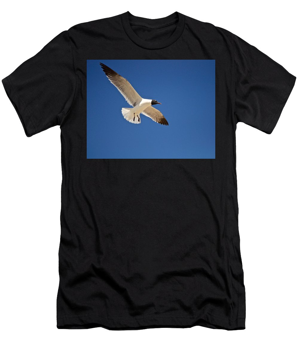 Seagull Print Men's T-Shirt (Athletic Fit) featuring the photograph Soaring Above The Sea by Kristina Deane