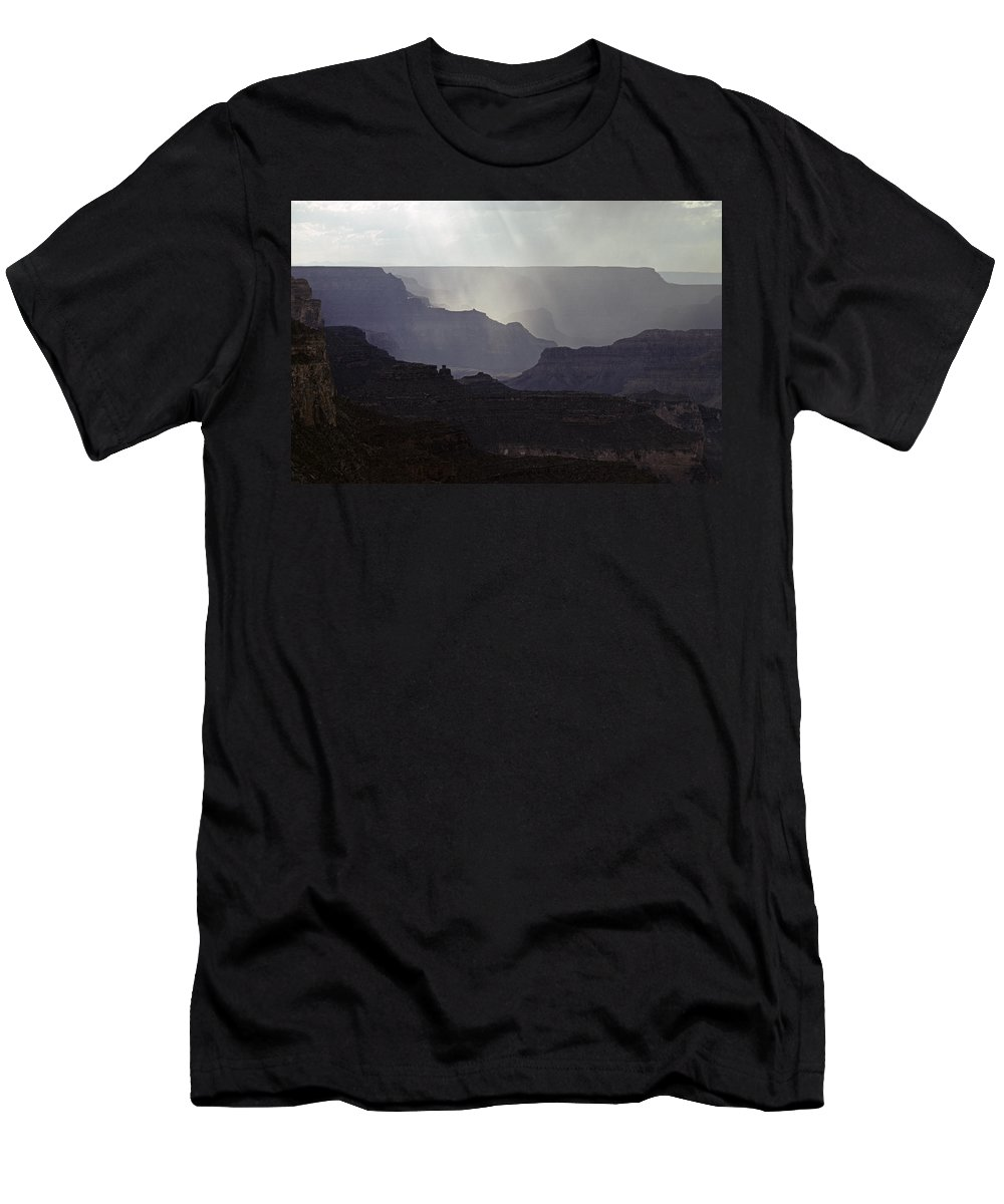 Grand Canyon National Park Men's T-Shirt (Athletic Fit) featuring the photograph South Rim Grand Canyon Storm Clouds And Sunray Light On Rock For by Jim Corwin