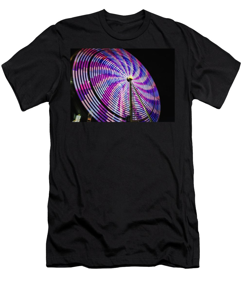Action Men's T-Shirt (Athletic Fit) featuring the photograph Spinning Disk by Joan Carroll