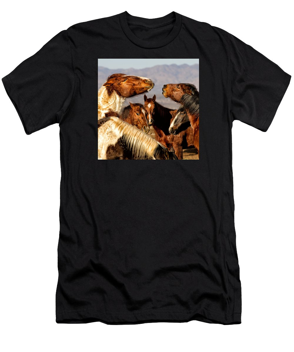 Horse Photography Men's T-Shirt (Athletic Fit) featuring the photograph The Discussion by Susan Kordish