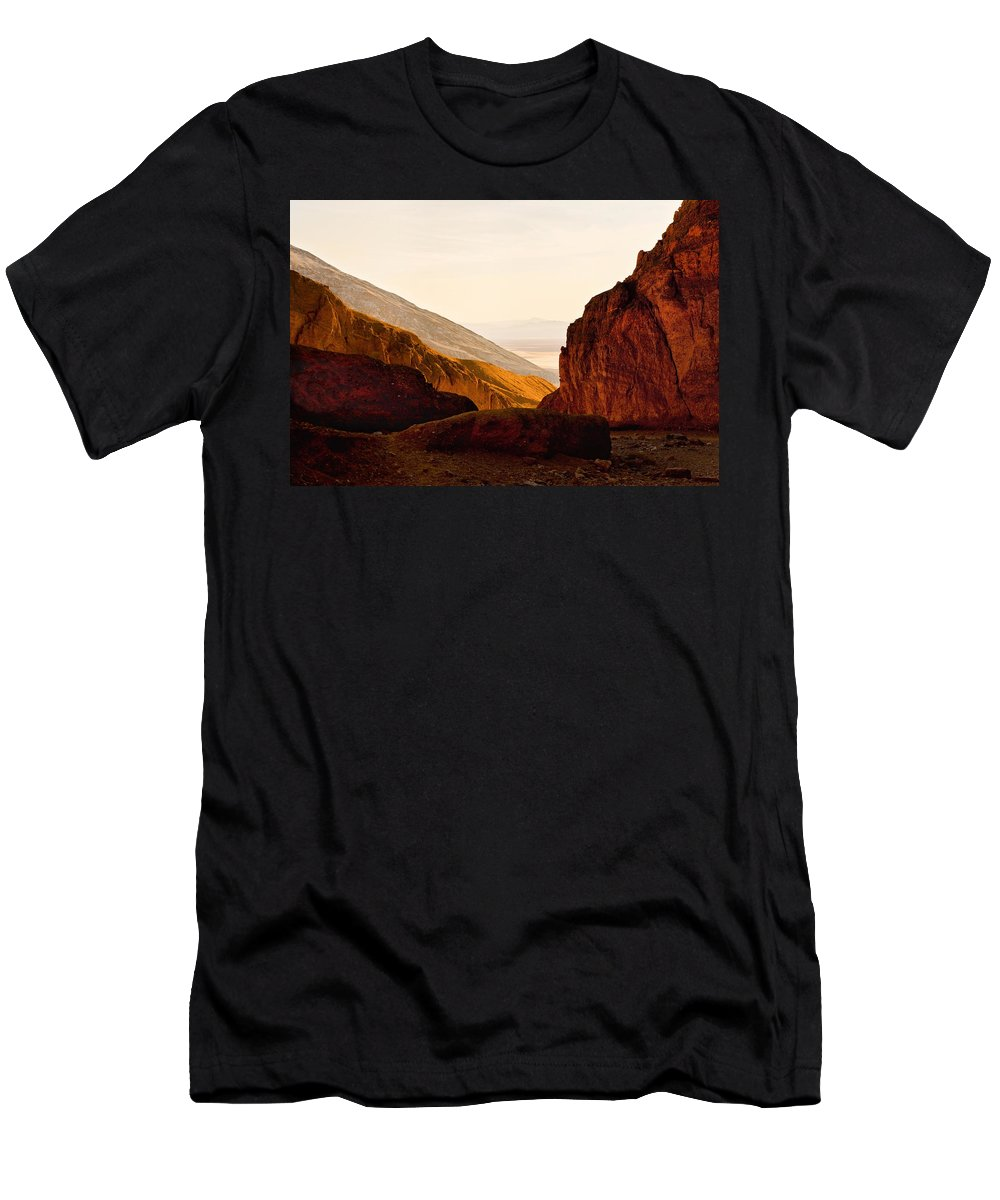 Evie Men's T-Shirt (Athletic Fit) featuring the photograph Valley Of Fire Morning Sun by Evie Carrier