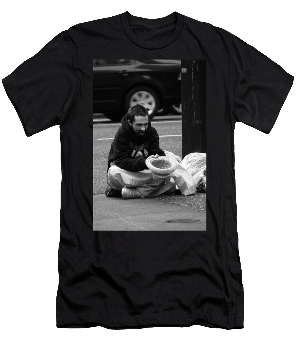 Street Photography Men's T-Shirt (Athletic Fit) featuring the photograph Wheels Keep Turning by The Artist Project