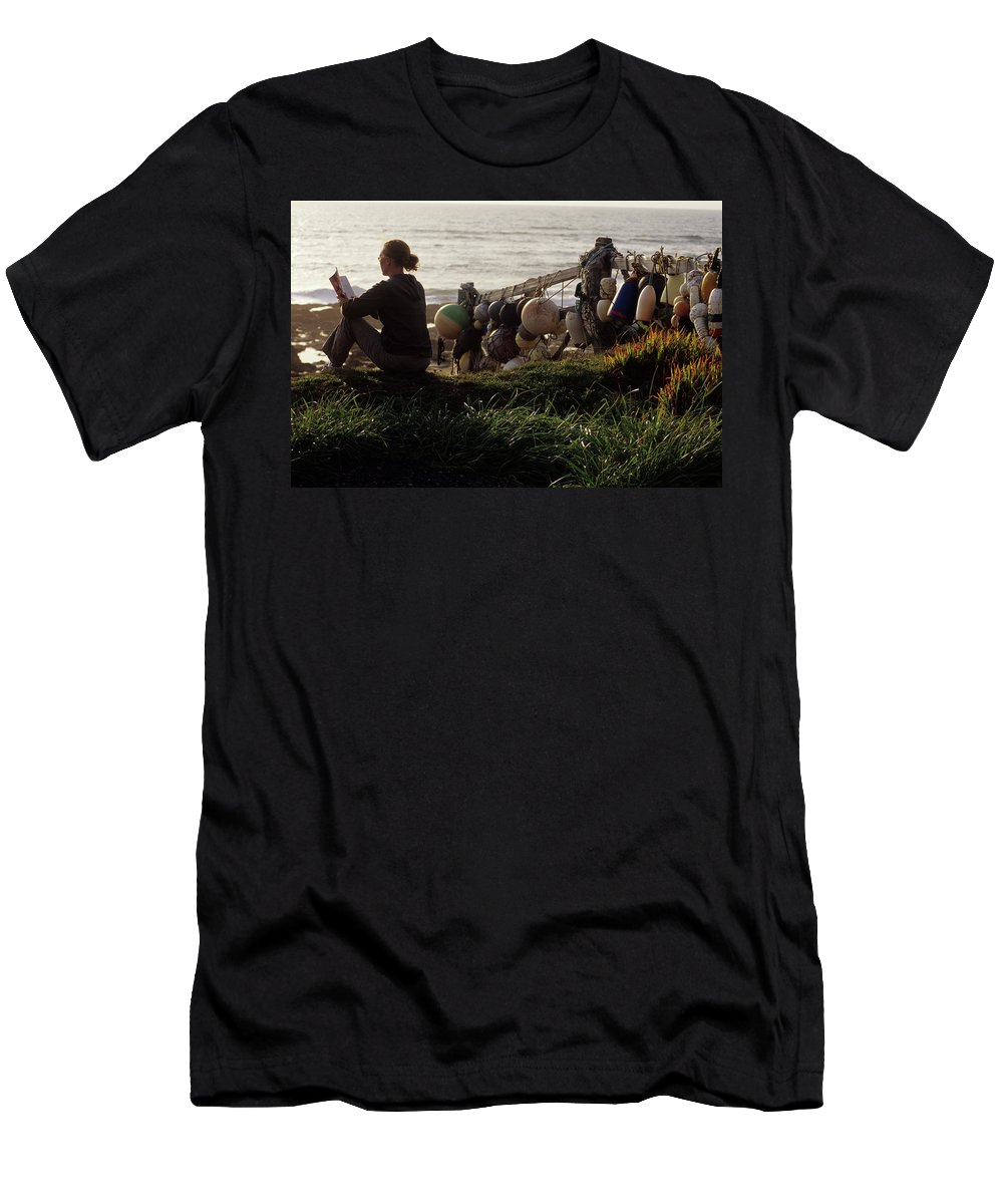 America Men's T-Shirt (Athletic Fit) featuring the photograph Woman Reads Book By Ocean. Northern by Rich Wheater
