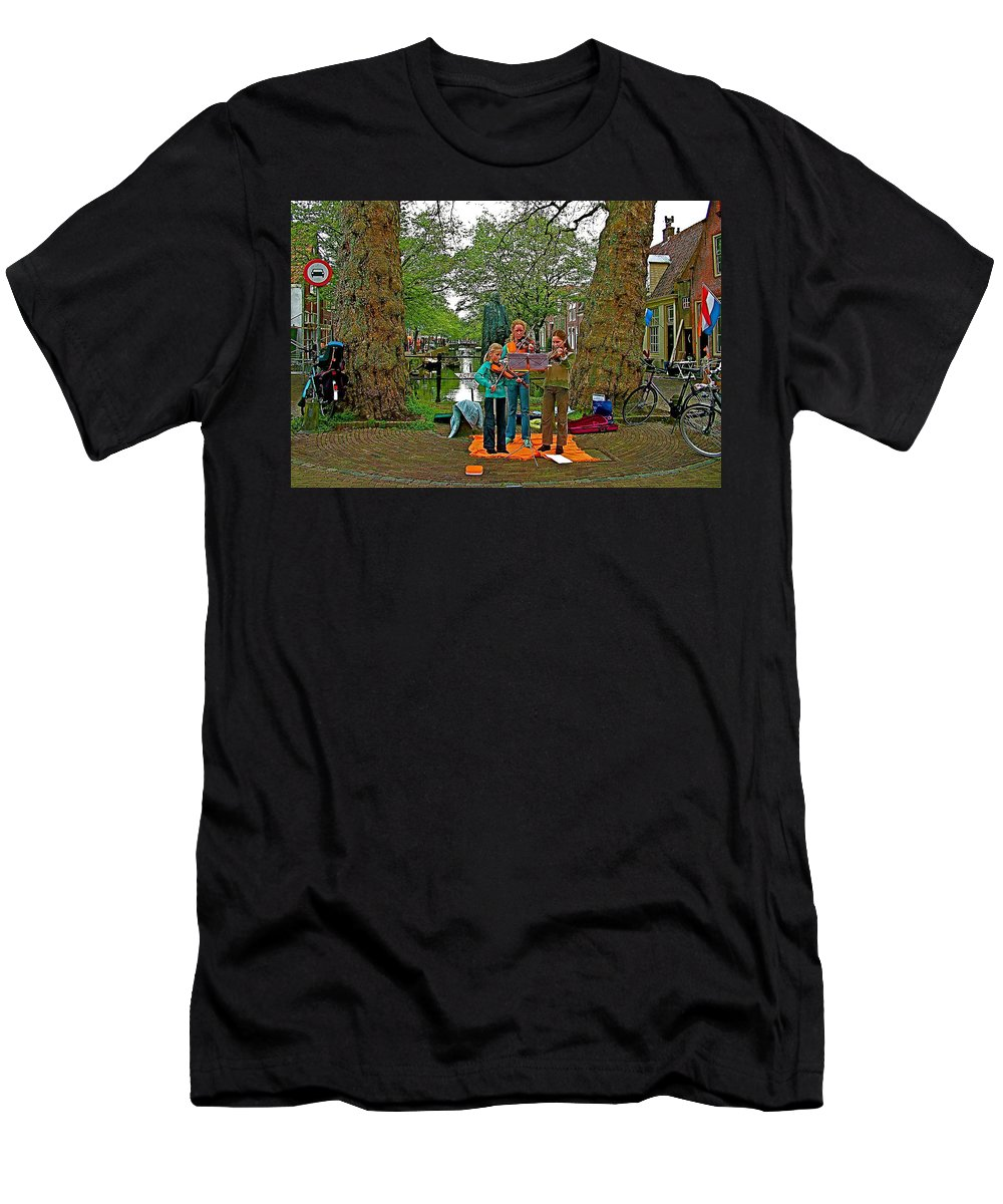 Young Musicians On Orange Day By A Canal In Enkhuizen Men's T-Shirt (Athletic Fit) featuring the photograph Young Musicians On Orange Day By A Canal In Enkhuizen-netherland by Ruth Hager