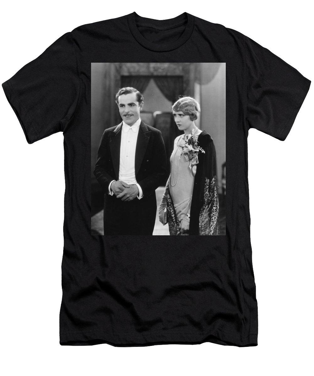 -ecq- Men's T-Shirt (Athletic Fit) featuring the photograph Silent Still: Man & Woman by Granger