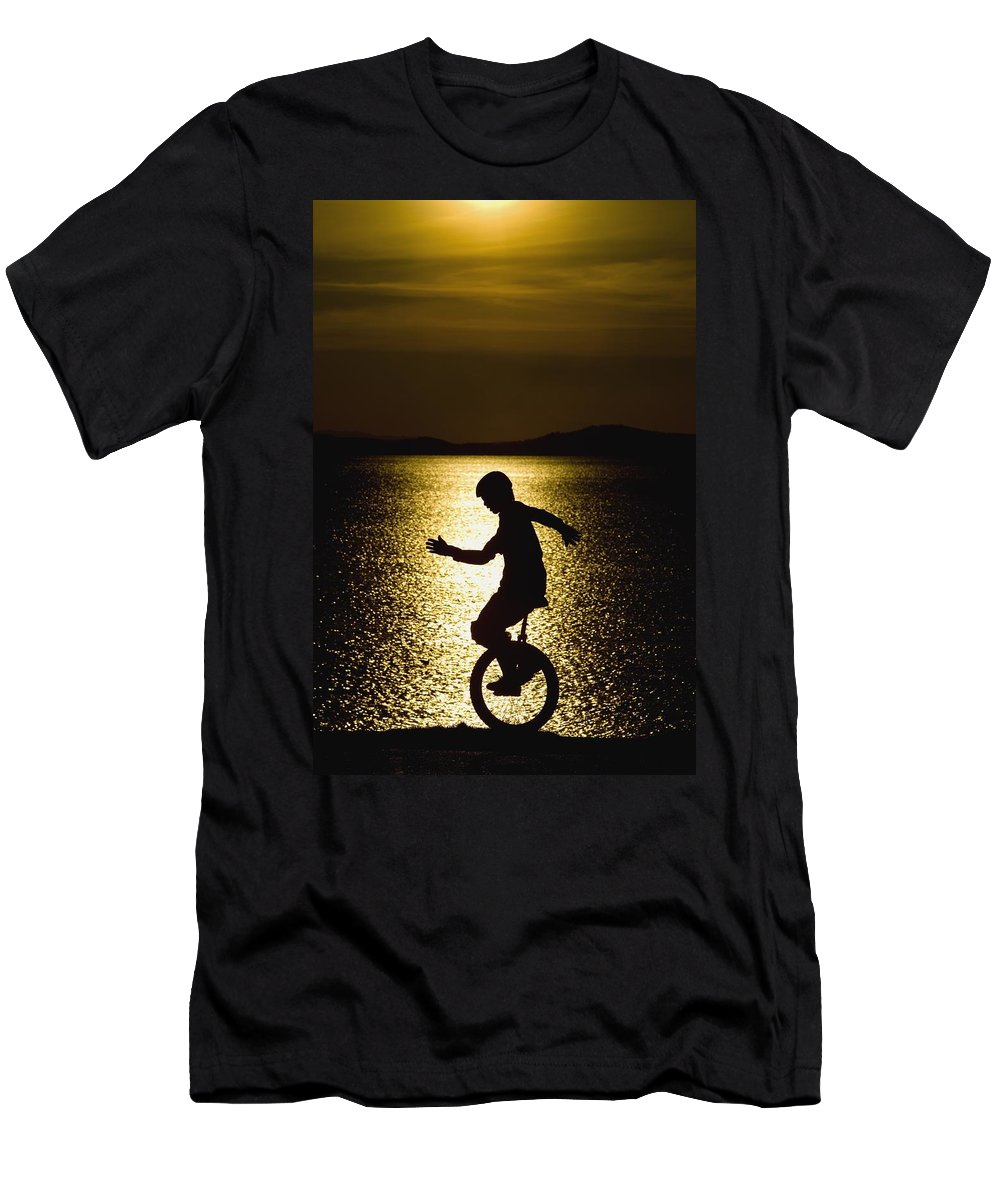 Activity Men's T-Shirt (Athletic Fit) featuring the photograph Unicycling Silhouette by Deddeda