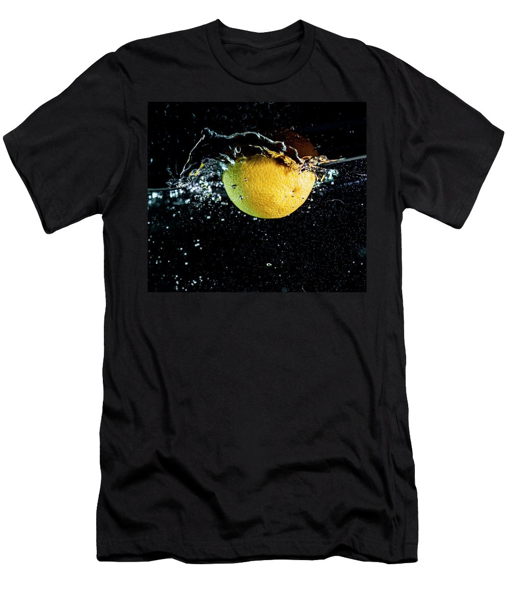 Water Men's T-Shirt (Athletic Fit) featuring the photograph Orange Splashing In Water by Trond Kristensen
