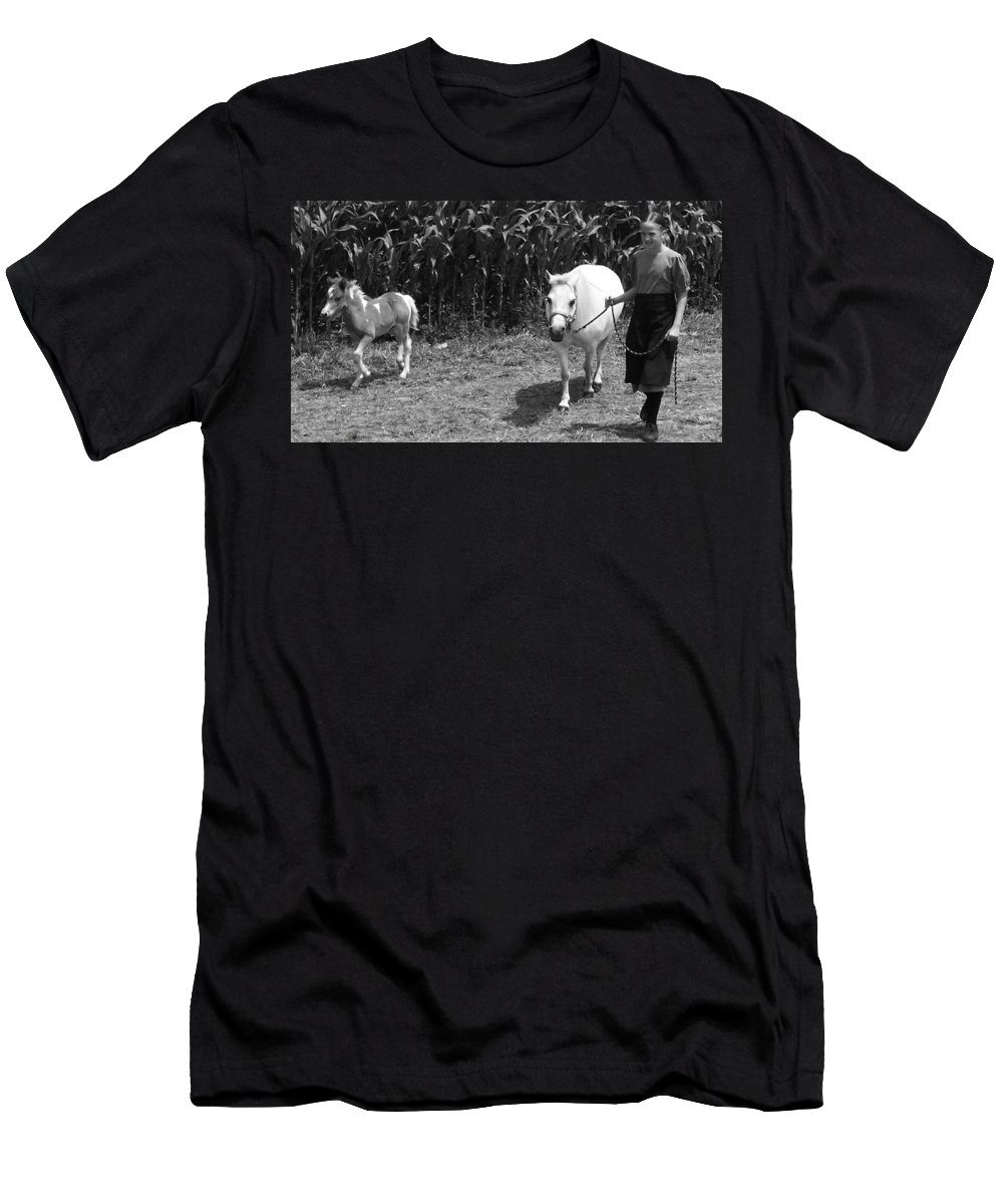 Amish Girl With Her Colt Men's T-Shirt (Athletic Fit) featuring the photograph Amish Girl With Her Colt by Eric Schiabor