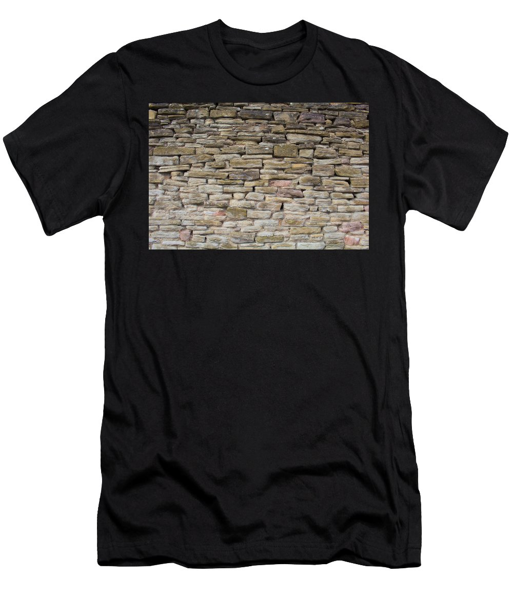 Rock Men's T-Shirt (Athletic Fit) featuring the photograph An Uneven Rock/stone/brick Wall by Rikki Prince