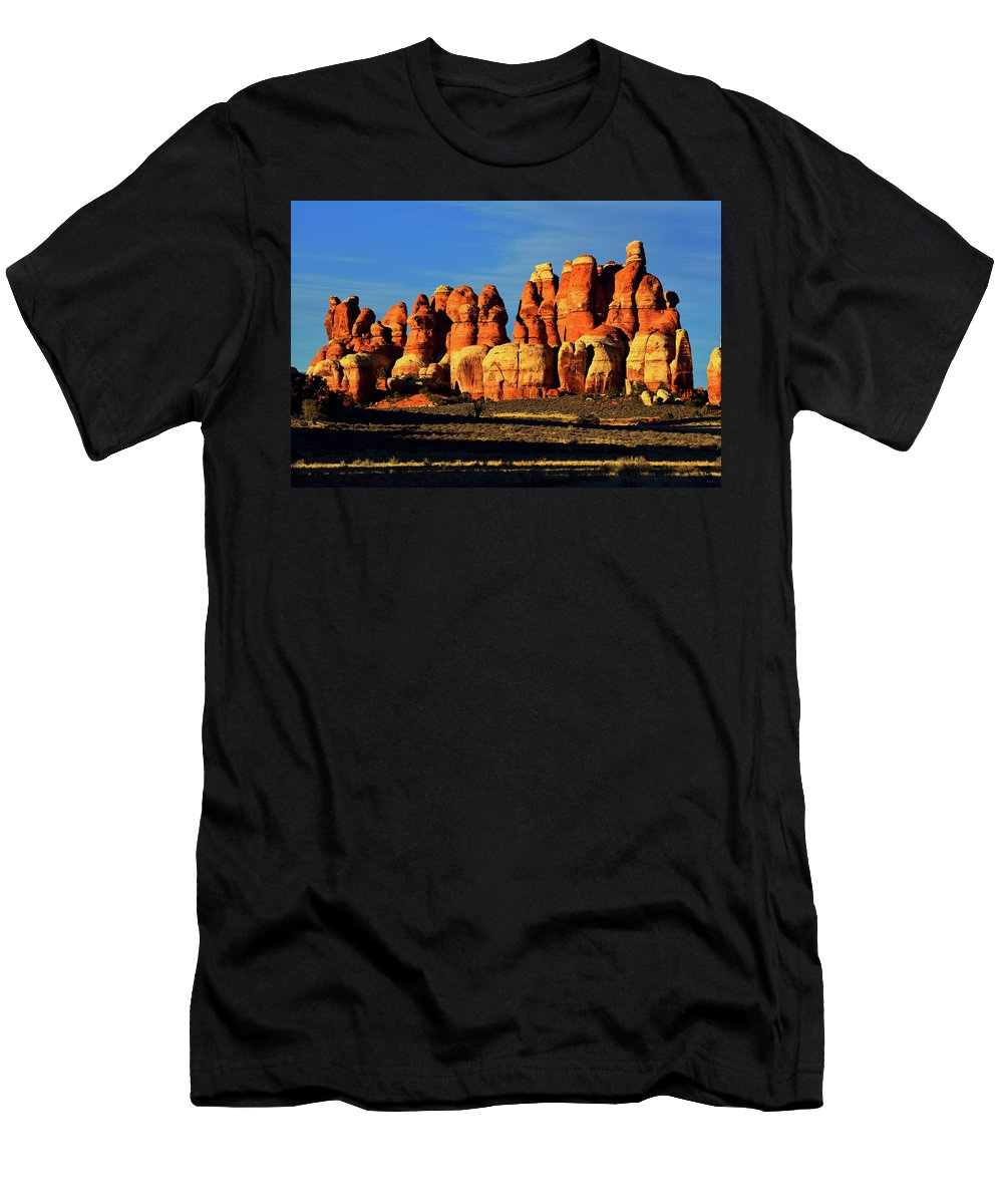 Canyonlands National Park Men's T-Shirt (Athletic Fit) featuring the photograph Chesler Park Sandstone Towers by Greg Norrell
