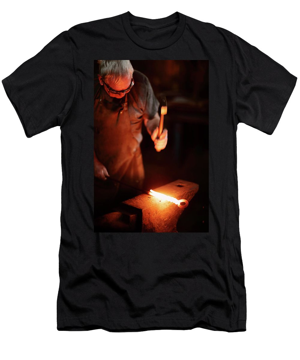 Blacksmith Men's T-Shirt (Athletic Fit) featuring the photograph Close-up Of Blacksmith Forging Hot Iron by Johan Swanepoel