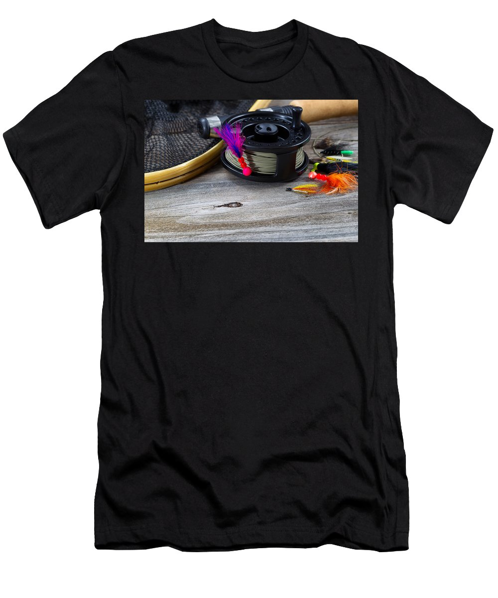Fishing Men's T-Shirt (Athletic Fit) featuring the photograph Close Up Of Fly Reel With Fly Jig Hanging From Spool by Thomas Baker