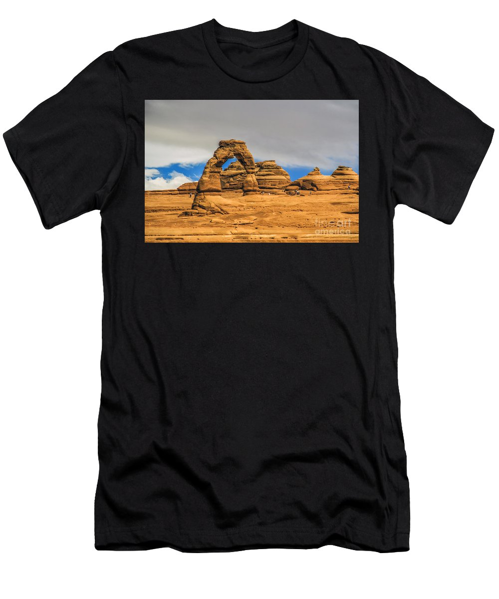 Arches Men's T-Shirt (Athletic Fit) featuring the photograph Clouds Over Delicate Arch by Roberta Bragan