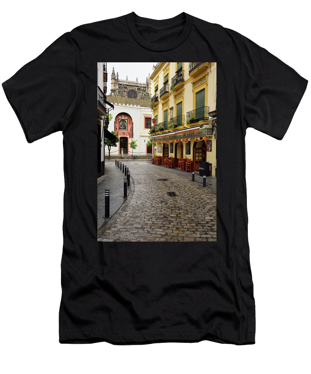 Narrow Men's T-Shirt (Athletic Fit) featuring the photograph Cobblestone Argote De Molina Street With Cafe Ending At The Nort by Reimar Gaertner