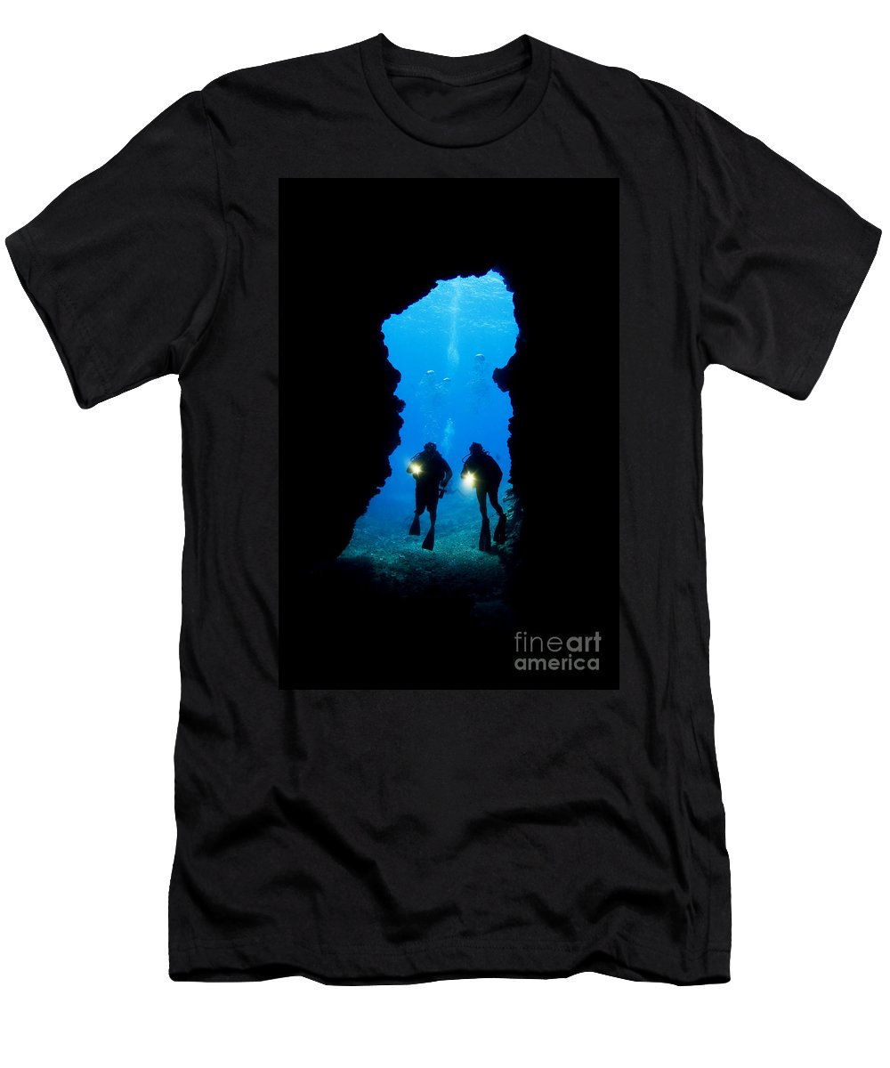 Beautiful Men's T-Shirt (Athletic Fit) featuring the photograph Divers Silhouetted Through Reef by Dave Fleetham - Printscapes