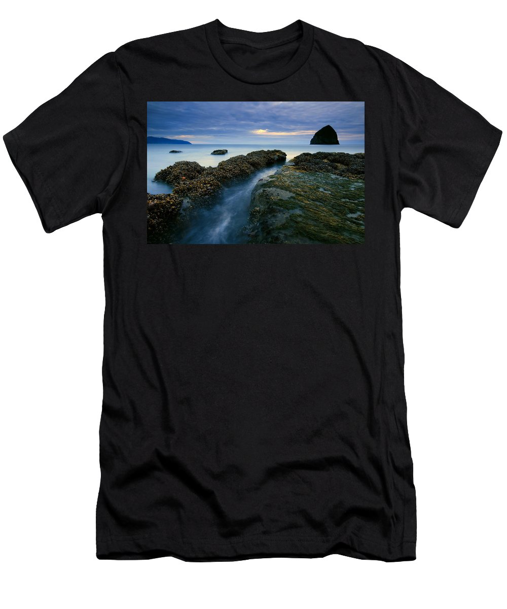 Haystack Rock Men's T-Shirt (Athletic Fit) featuring the photograph Dusk At Kiwanda by Mike Dawson