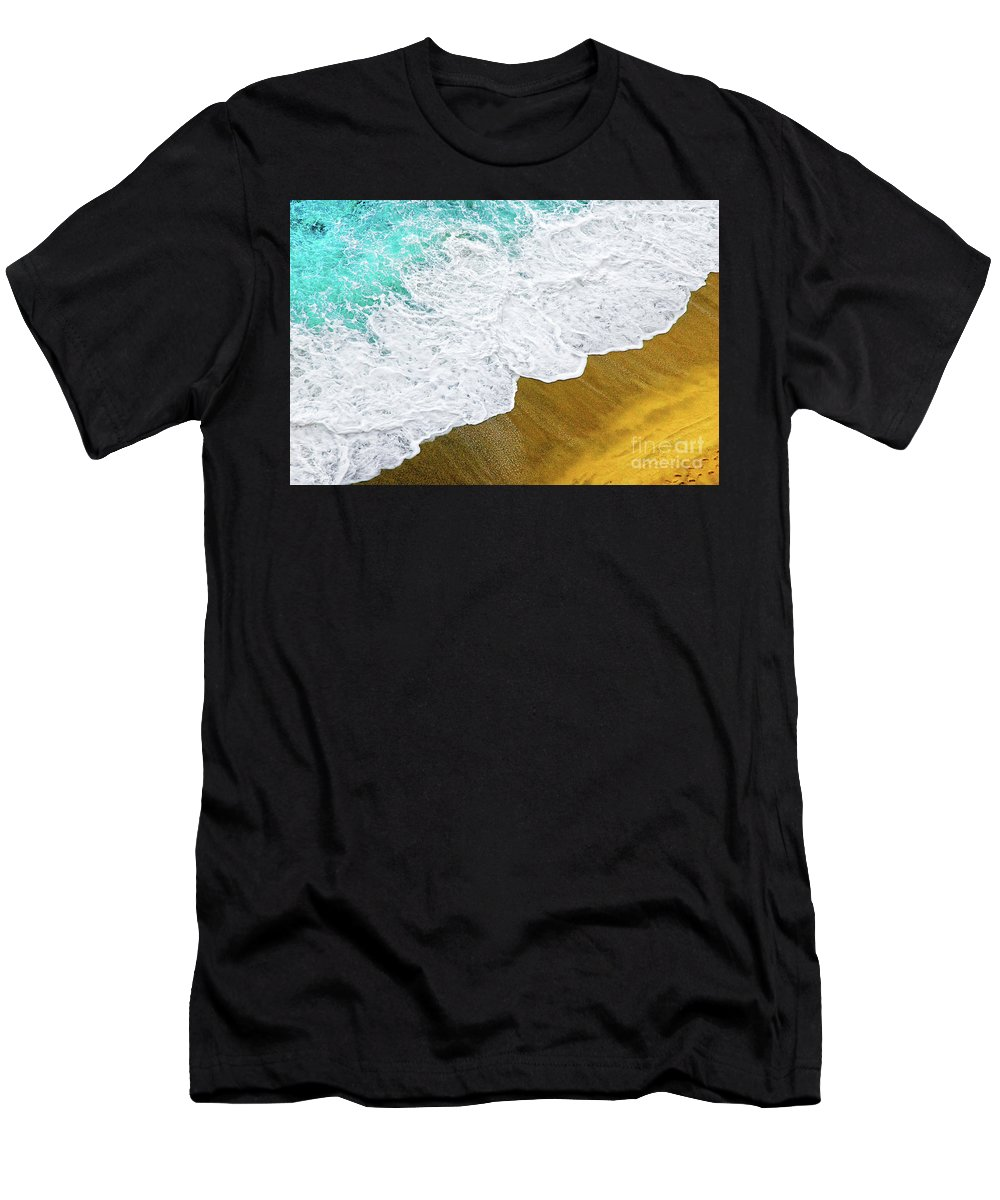 Water Men's T-Shirt (Athletic Fit) featuring the photograph Footsteps In The Sand Hopelessly Facing The Rising Tide by Silvia Ganora