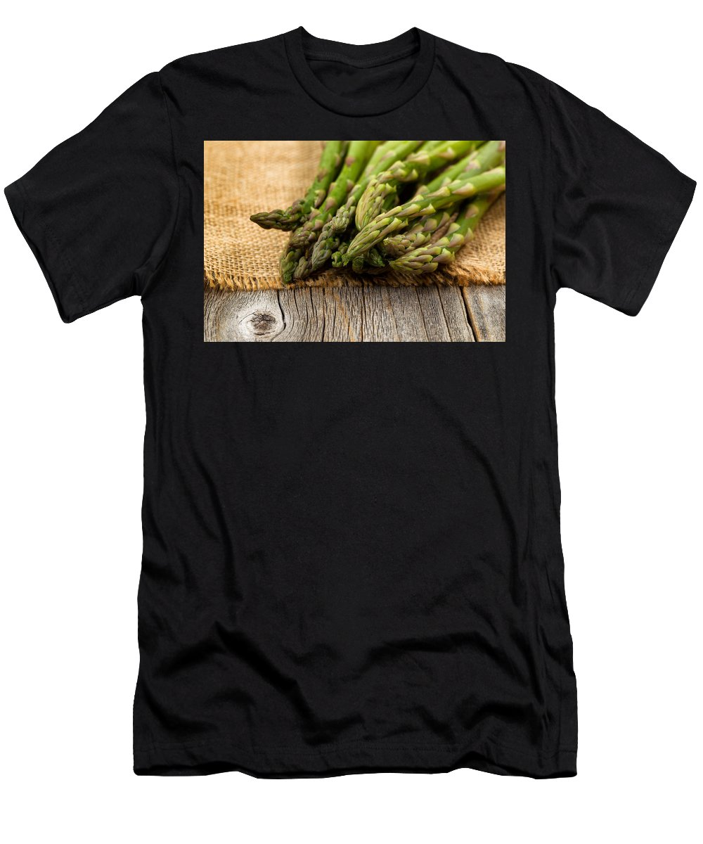 Asparagus Men's T-Shirt (Athletic Fit) featuring the photograph Fresh Asparagus On Napkin And Rustic Wood by Thomas Baker
