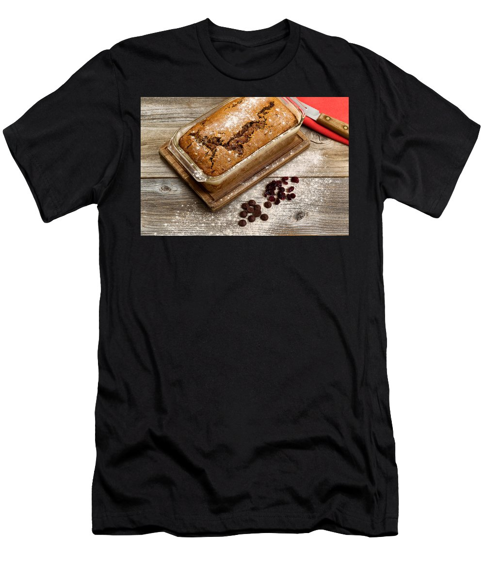 Bread Men's T-Shirt (Athletic Fit) featuring the photograph Freshly Baked Zucchini Bread On Rustic Wooden Boards by Thomas Baker