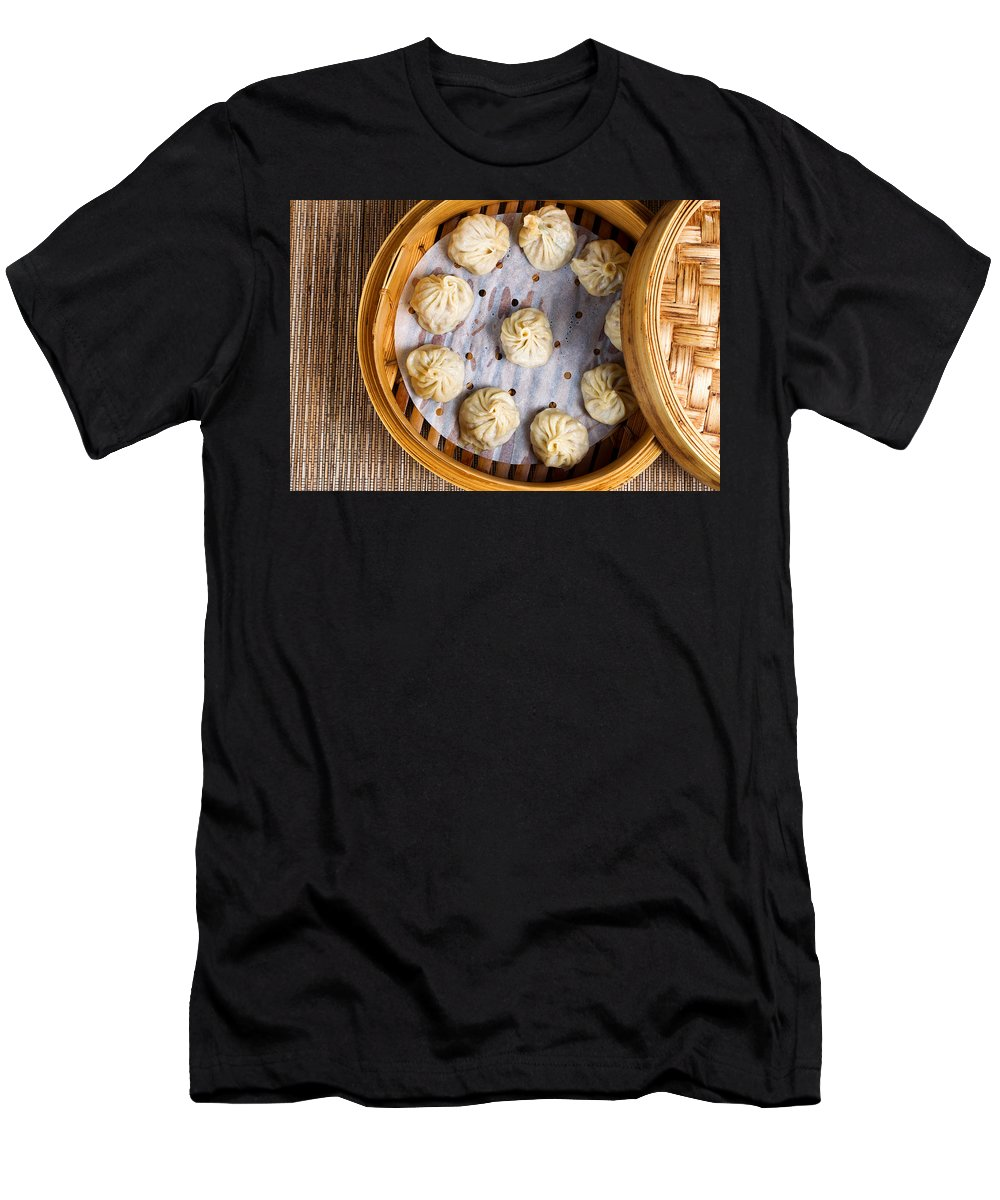 Chinese Men's T-Shirt (Athletic Fit) featuring the photograph Freshly Cooked Dumplings Inside Of Bamboo Steamer Ready To Eat by Thomas Baker