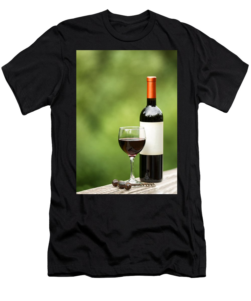 Wine Men's T-Shirt (Athletic Fit) featuring the photograph Glass Of Red Wine Outdoors Ready To Enjoy by Thomas Baker