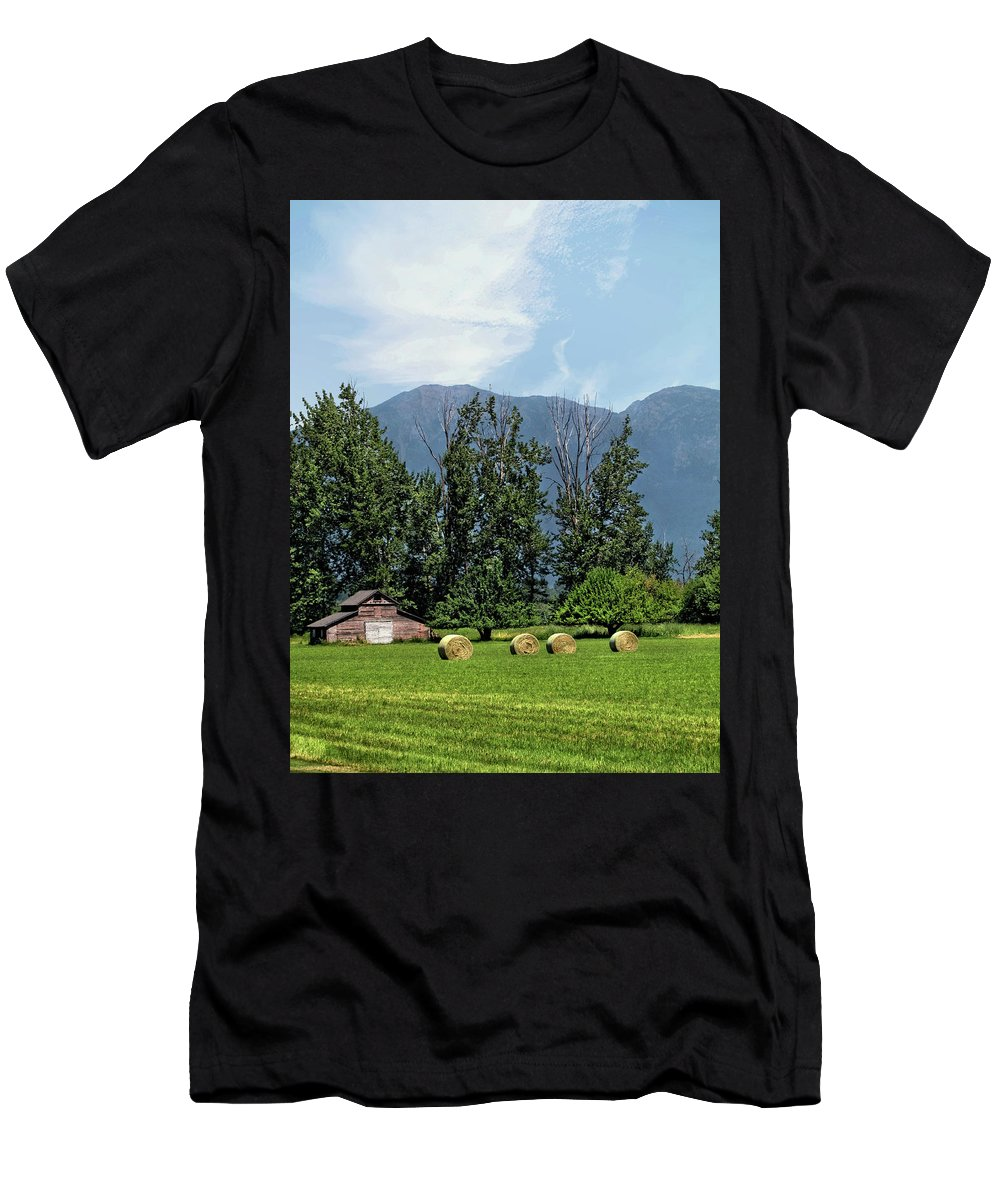 Farm Men's T-Shirt (Athletic Fit) featuring the photograph Hay Bales And A Barn - Kalispell Montana by John Trommer