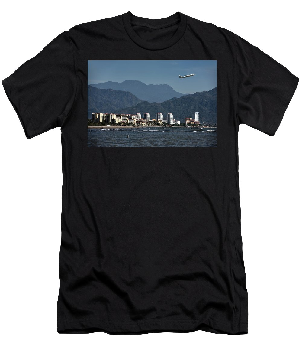Jet Men's T-Shirt (Athletic Fit) featuring the photograph Jet Plane Taking Off From Puerto Vallarta Airport With Pacific O by Reimar Gaertner