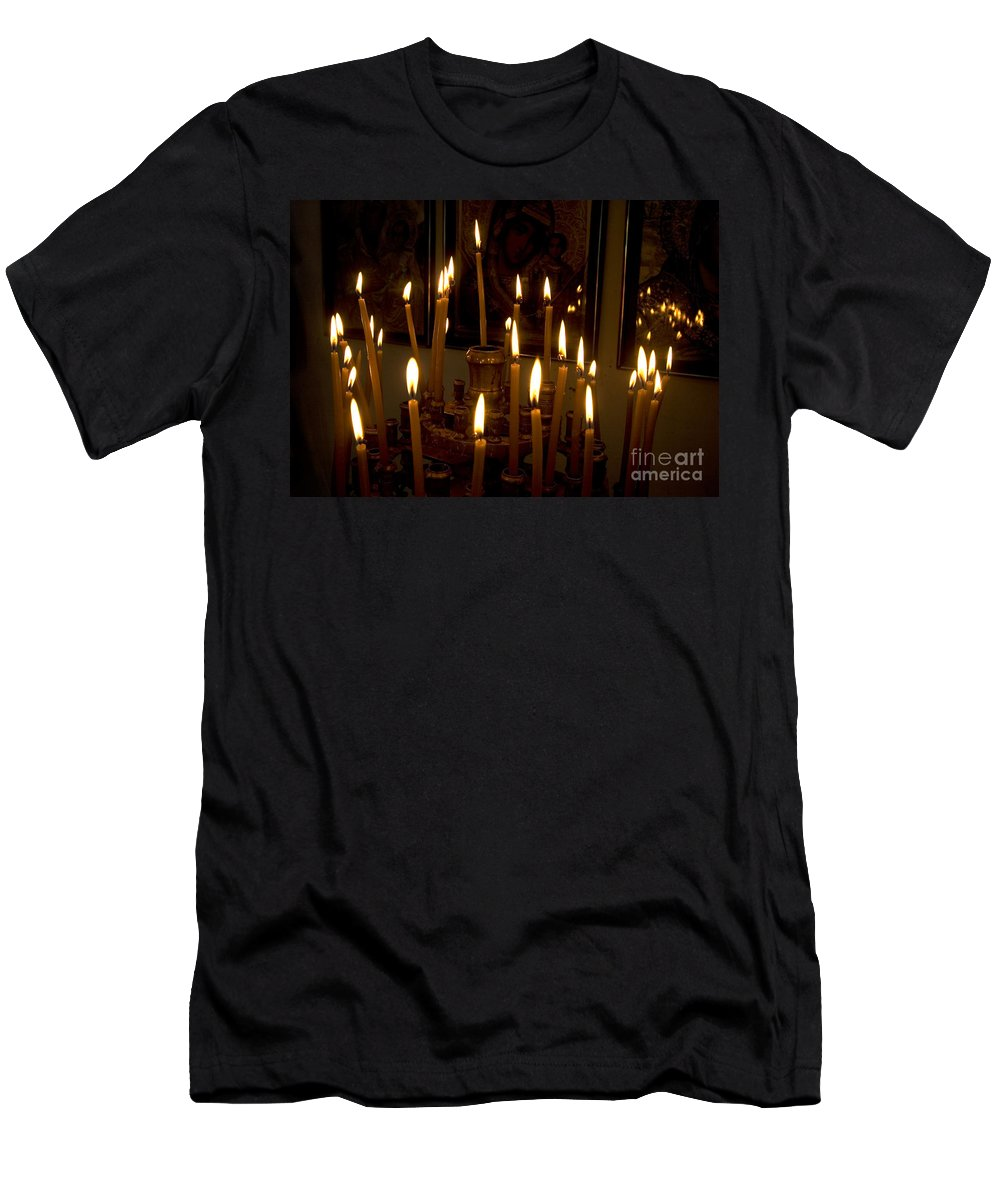 Lit Men's T-Shirt (Athletic Fit) featuring the photograph lit Candles in church by Danny Yanai