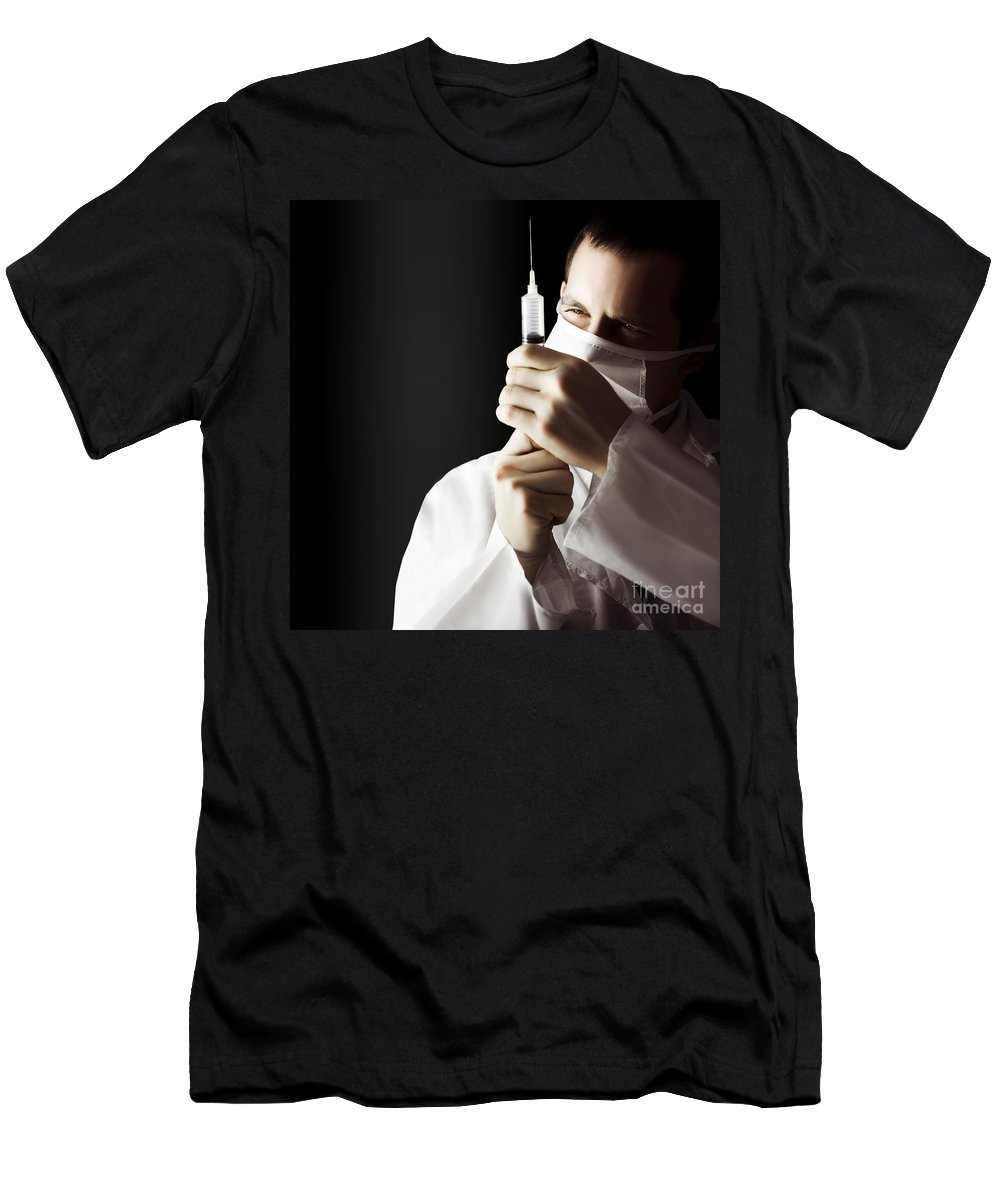 Care Men's T-Shirt (Athletic Fit) featuring the photograph Male Doctor With Needle Syringe On Dark Background by Jorgo Photography - Wall Art Gallery