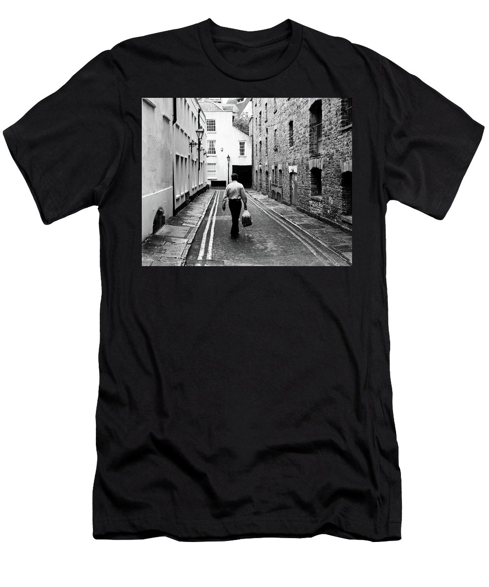Architecture Men's T-Shirt (Athletic Fit) featuring the photograph Man Walking With Shopping Bag Down Narrow English Street by Jacek Wojnarowski