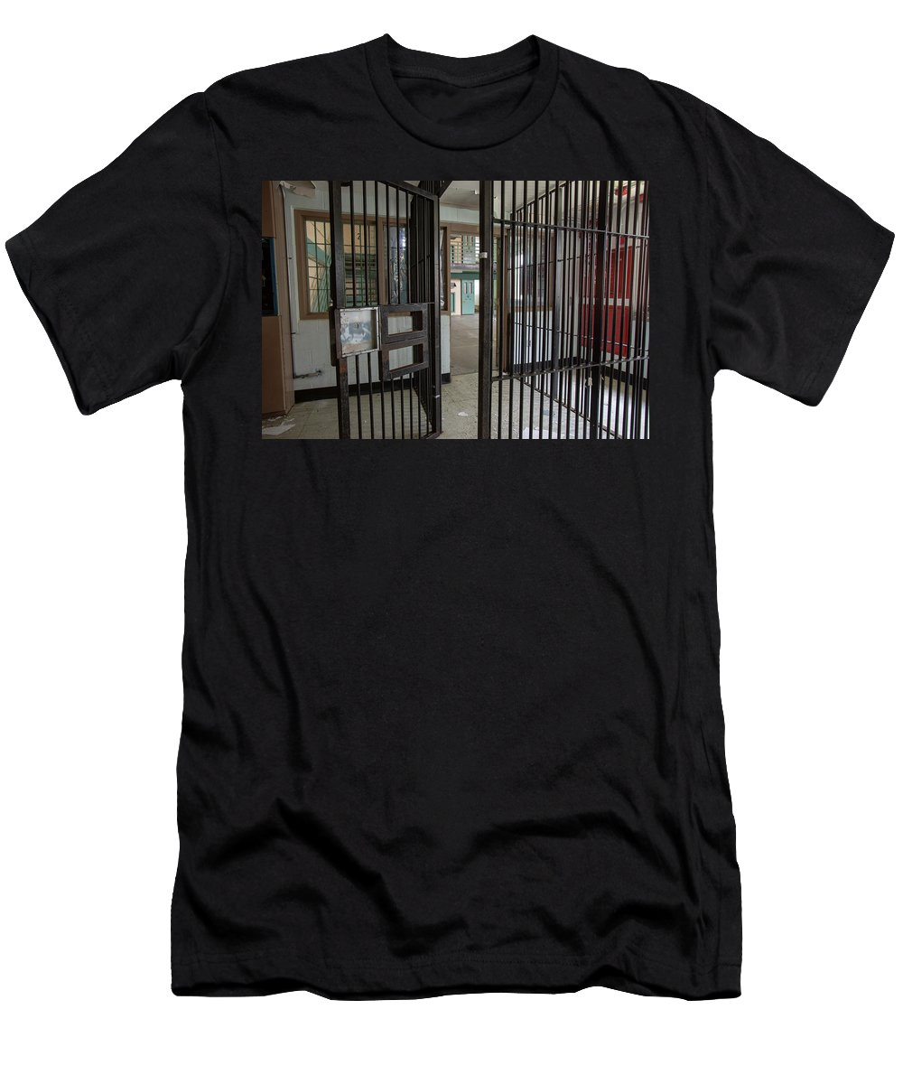 Abandoned Men's T-Shirt (Athletic Fit) featuring the photograph Metal Bars Leading Into Cellblock In Prison by Karen Foley
