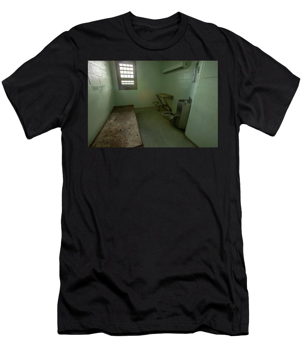 Abandoned Men's T-Shirt (Athletic Fit) featuring the photograph Metal Bed Inside Solitary Confinement Cell by Karen Foley