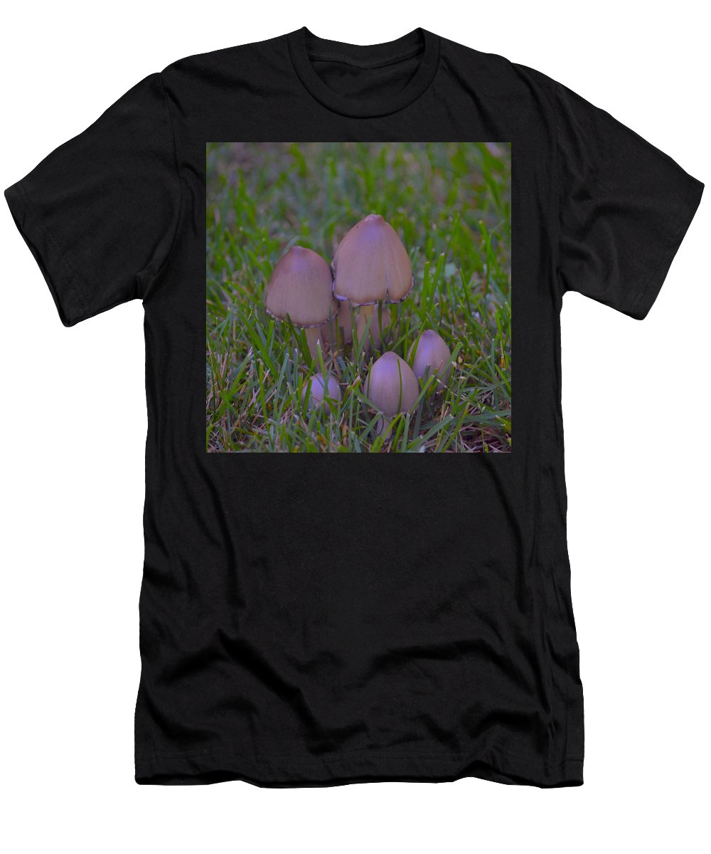 Mushrooms Men's T-Shirt (Athletic Fit) featuring the photograph Mushrooms In Grass by Hella Buchheim