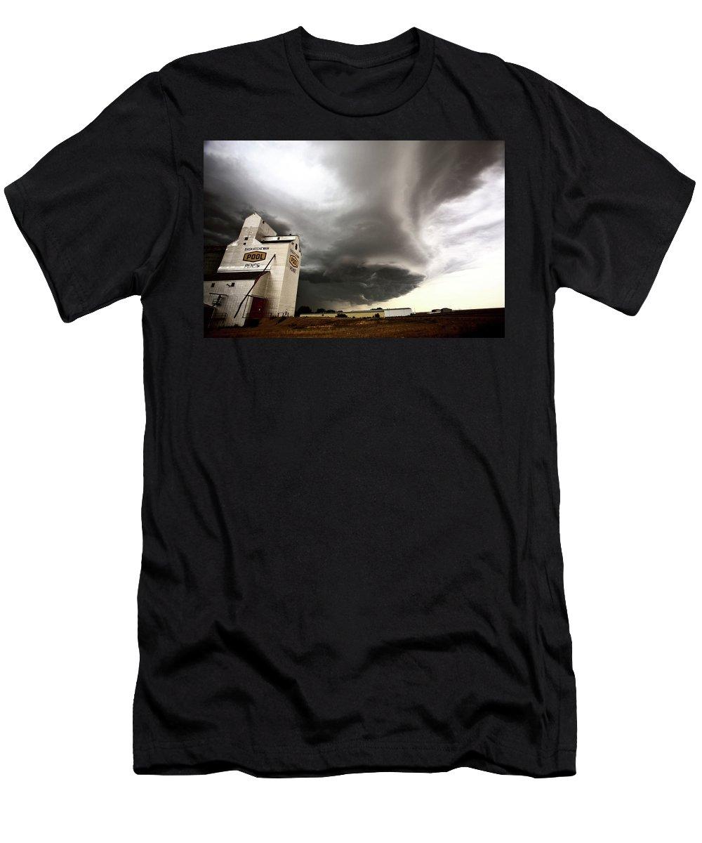 Grain Elevator Men's T-Shirt (Athletic Fit) featuring the digital art Nasty Looking Cumulonimbus Cloud Behind Grain Elevator by Mark Duffy
