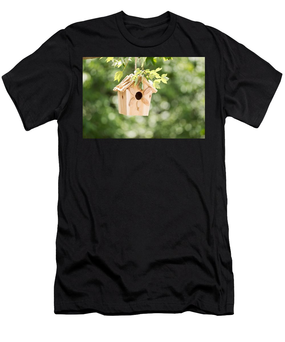 Birdhouse Men's T-Shirt (Athletic Fit) featuring the photograph New Wooden Birdhouse Hanging On Tree Branch Outdoors by Thomas Baker